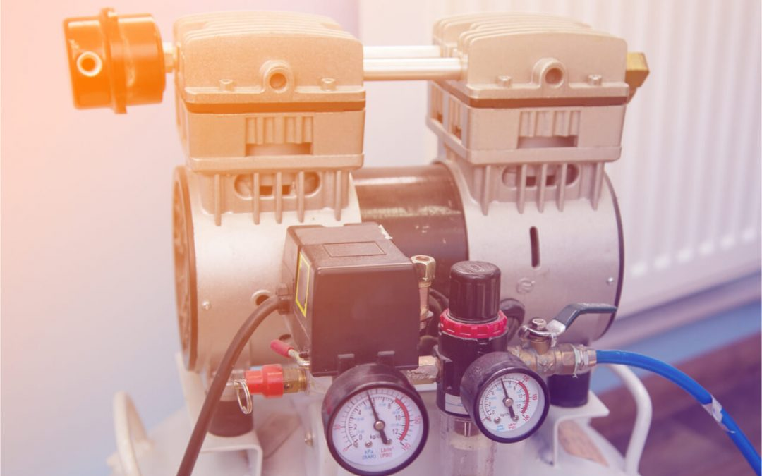 What is a dental air compressor?