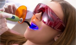 The dental professional uses modern technology to improve dental treatment.